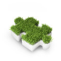 Grass covered puzzle piece Royalty Free Stock Photography