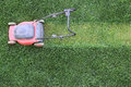 Grass cutter at the lawn cuts green Stock Images