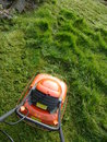 Grass cutting first chance in spring to mow the Royalty Free Stock Photo