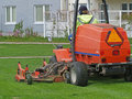Grass cutting tractor Royalty Free Stock Photo