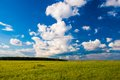 Grass field and dramatic sky at sunset landscape with Stock Photo