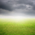 Grass fields and beautiful rainclouds blue Royalty Free Stock Images
