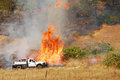 Grass fire a natural cover bing extinguished by a forest crew Royalty Free Stock Photo