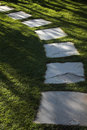 Grass lawn and stone garden path Stock Photo