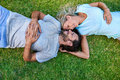 Grass laying couple Royalty Free Stock Photo