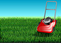 Grass and mow cutter cuts the green lawn Stock Photography