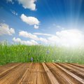 Grass photo of meadow and blue sky with wooden desk Stock Photo