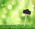 Grass with sign spring bokeh background and information Stock Photography