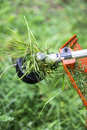 Grass trimmer head in use iarba mow cutter Stock Images