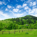 Grassland with fence and rural house Royalty Free Stock Photo