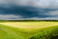 Grassland and storm cloud green Stock Images