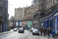 Grassmarket edinburgh shops on the cobbled street of part of s old town in the shadow of castle Royalty Free Stock Image