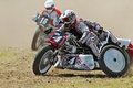 Grasstrack sidecar puttenham uk august an unnamed team power around a bend at the h smcc championships on august in Royalty Free Stock Photography