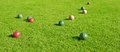 Grassy Area with Bocce Balls Game Royalty Free Stock Photo
