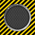Grate background with yellow and black tape Stock Photos