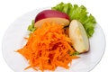 Grated carrots apple lettuce white plate Stock Photos