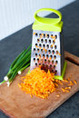 Grated carrots cooking delicious and healthy food at the kitchen Royalty Free Stock Photography