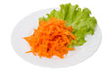 Grated carrots lettuce white plate Stock Images