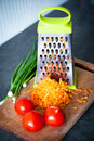 Grated carrots and tomatos cooking delicious healthy food Royalty Free Stock Photos