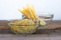 Grated cheese in glass bowl Stock Photos
