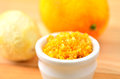 Grated citrus rind orange and lemon cooking ingredient close up Stock Image
