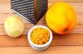 Grated citrus rind orange and lemon and grater Stock Photo