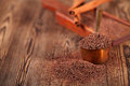 Grated dark chocolate in copper measure pan Royalty Free Stock Photo