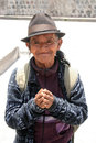 A grateful homeless man hispanic with folded hands and smile begging on the street in cotacachi ecuador Stock Images