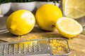 Grater peel and lemon zest on the wooden table Royalty Free Stock Photo