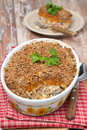 Gratin with fish and pumpkin in a ceramic form vertical Royalty Free Stock Photography