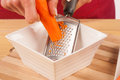 Grating carrots Stock Photos