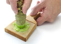 Grating fresh wasabi by shark skin grater japanese condiment Stock Image