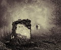 Grave in a forest wedding couple walking away from Royalty Free Stock Image
