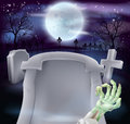 Grave halloween background of zombie arm and a gravestone in a graveyard with full moon in the copyspace on the Stock Images