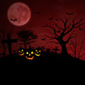 Grave and halloween pumpkin under red full moon background of pumpkins on graveyard Royalty Free Stock Image