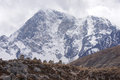Grave mountain stone monuments to dead mountaineers below great white himalayan Stock Images