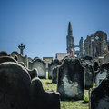 Grave yard with headstones in front of whitby abbey Royalty Free Stock Images