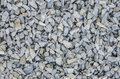 Gravel abstract background ballast boulder Royalty Free Stock Photo