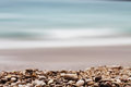 Gravel depth of field and sea background with theme Stock Photo