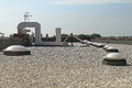 Gravel flat roof with and skylight windoows Royalty Free Stock Photo