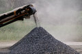 Gravel machine pouring stones into a pile Royalty Free Stock Photos