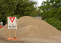 Gravel pile is piled at the roadside during the roadside construction Stock Images