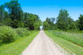 Gravel road in countryside wirh railroad Royalty Free Stock Photos