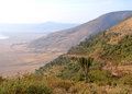 Gravel road leading  down to Ngorongoro crater i Stock Photos