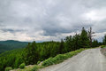 Gravel road in a mountain valley at the top of the Altai Mountains Summer Royalty Free Stock Photo