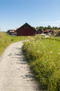 Gravel road summertime sweden leading to ramsmora harbour möja möja is one of the larger islands i stockholm archipelago Royalty Free Stock Image