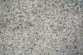 Gravel wall texture with a covering of small stone chips giving an attractive mottled rough textured finish Stock Images