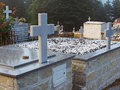 Graves and crosses in cemetery raised stone with marble small Stock Photo