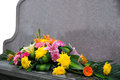 Gravestone and flower a bunch of flowers front of Royalty Free Stock Photography