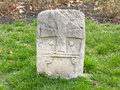 Gravestone old on grass field Royalty Free Stock Images